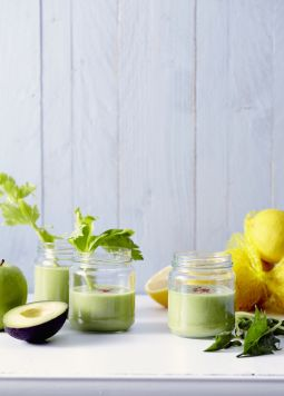 Green-smoothie-with-avocado-and-spinach - Three glasses with green smoothie on a white table - © Have a Dream