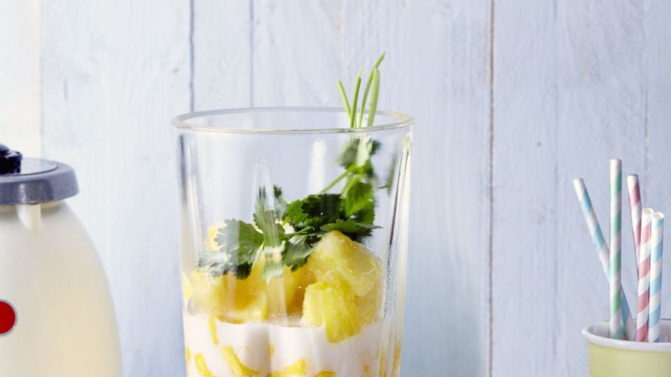 Smoothie with mango, pineapple and coriander - Mango, pineapple, coriander Dream Coconut Rice Drink in a blender.